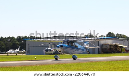 MIDDLESEX, VA - SEPTEMBER 27, 2014: A Bellanca Citabria 115 at liftoff on the runway at Hummel field airport in the wings wheels and keels annual show at the Hummel airfield airstrip in Middlesex VA