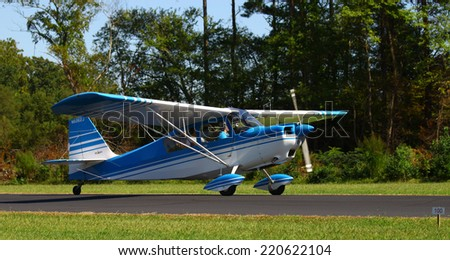 MIDDLESEX, VA - SEPTEMBER 27, 2014: A Bellanca Citabria 115 taxiing up the runway at Hummel field airport in the wings wheels and keels annual show at the Hummel airfield airstrip in Middlesex VA
