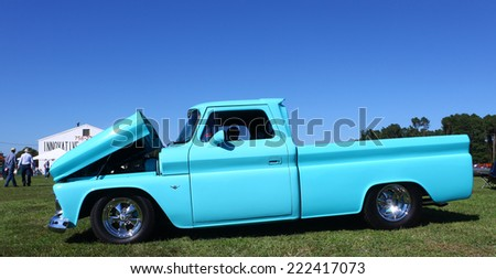 MIDDLESEX, VA - SEPTEMBER 27, 2014: A 64 GMC pickup truck at hummel field airport runway in the wings wheels and keels annual show at the Hummel airfield airstrip in Middlesex VA