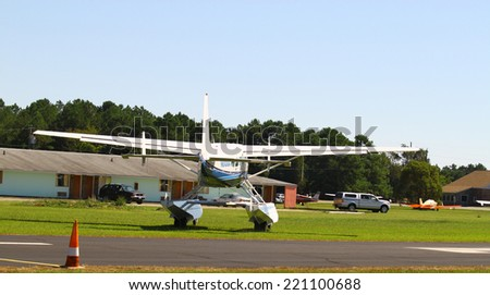 MIDDLESEX, VA - SEPTEMBER 27, 2014: A large blue and white seaplane on the runway at Hummel field airport in the wings wheels and keels annual show at the Hummel  airfield airstrip in Middlesex VA
