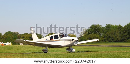 MIDDLESEX, VA - SEPTEMBER 27, 2014: A small private plane waiting to access the runway at Hummel field airport in the wings wheels and keels annual show at the Hummel airfield airstrip in Middlesex VA
