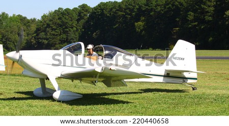 MIDDLESEX, VA - SEPTEMBER 27, 2014: A small white personal aircraft/airplane in  the wings wheels and keels annual show at the Hummel airfield airstrip in Middlesex VA