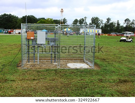 Middlesex, VIRGINIA - SEPTEMBER 26, 2015: A fenced in electrical supply sub station  at the Wings Wheels & Keels 19th annual event held each September in Middlesex VA