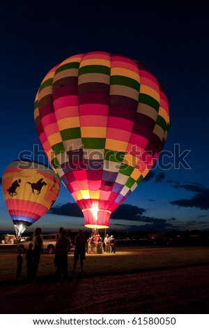 "MIDLAND, MICHIGAN-SEPTEMBER 17:  Hot air balloons in the 20th annual Balloon Festival are illuminated for a ""Night Glow""  in Midland, MI  on September 17, 2010. This year 65 balloons participated. - stock photo"
