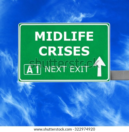 MIDLIFE CRISES road sign against clear blue sky - stock photo