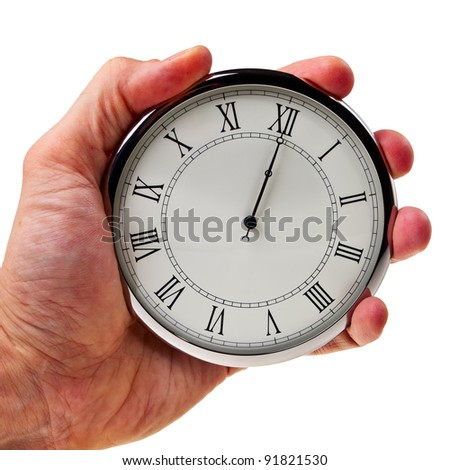 Midnight or noon on retro watch hold in male hand isolated over white background. - stock photo