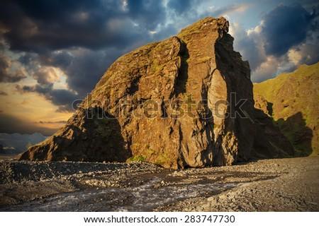 Midnight setting sun lits beautifully volcanic rocks at Thorsmork, Iceland - stock photo