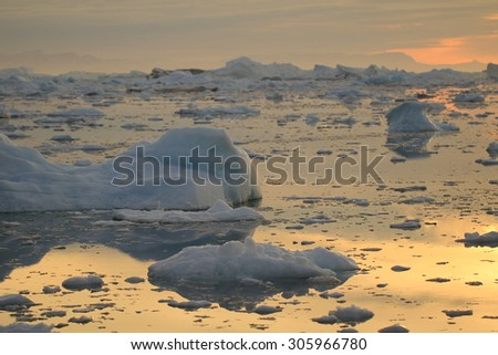 Midnight sun boat tour in Ilulissat, Greenland, before melting in 2012 - stock photo