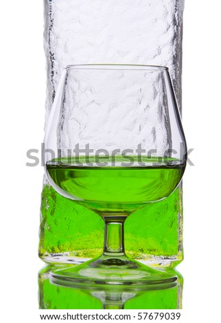 Midori liquor in glass and bottle