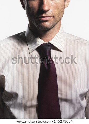 Midsection of a sweaty young businessman against white background - stock photo