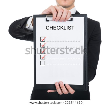 Midsection of businessman holding clipboard with checklist against white background - stock photo