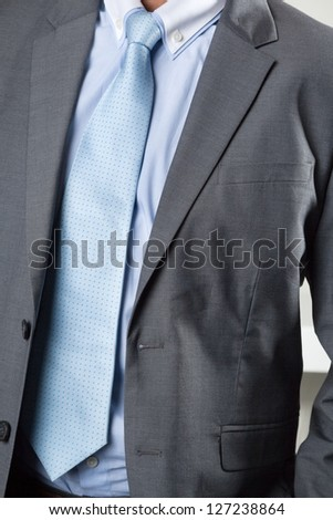 Midsection of businessman in suit - stock photo