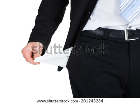 Midsection of businessman showing empty pocket over white background - stock photo