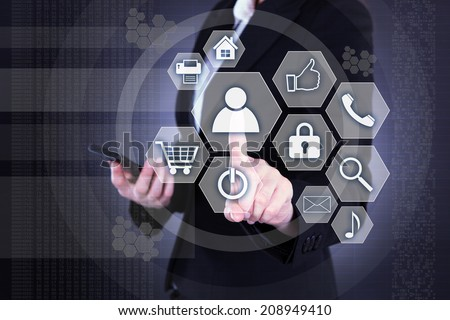 Midsection of businesswoman pressing buttons on virtual background - stock photo