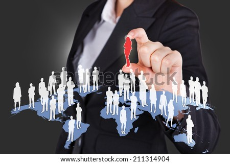 Midsection of businesswoman selecting candidate from all over the world. - stock photo