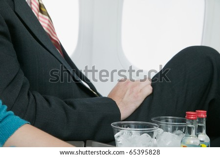 Midsection of couple with drinks - stock photo