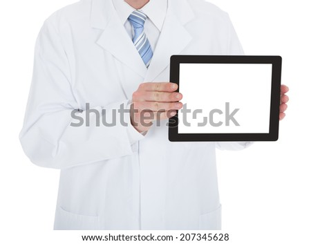 Midsection of doctor displaying digital tablet over white background - stock photo