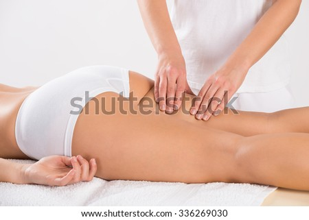 Midsection of female customer receiving leg massage in salon - stock photo
