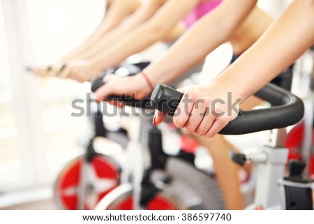 Midsection of sporty group of women on spinning class