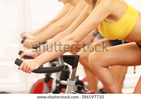 Midsection of sporty women group on spinning class - stock photo