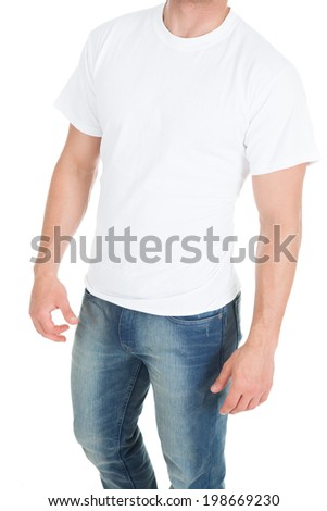 Midsection of young man wearing blank tshirt over white background