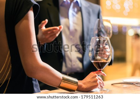 Midsection view of couple chatting in a wine shop