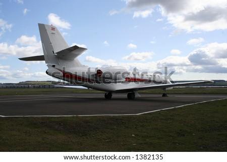 Midsize corporate jet - stock photo
