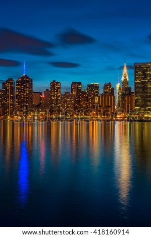 Midtown Manhattan NYC at nightfall, captured from Long Island City across the East River. - stock photo