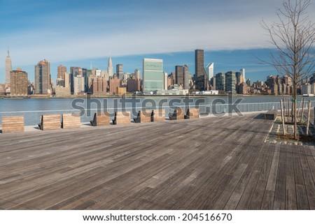 Midtown Manhattan Skyline as seen from Gantry Park Plaza in Queens, New York - stock photo