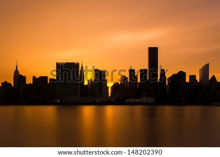 Midtown Manhattan Skyline from Gantry Plaza State Park in Queens New York. You can see the Empire State Building, and Chrysler Tower from this view over the East River - stock photo
