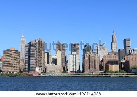 Midtown Manhattan skyline on a clear day, New York City - stock photo