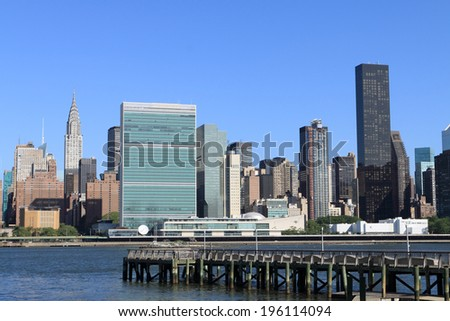 Midtown Manhattan skyline on a clear day, New York City - stock photo
