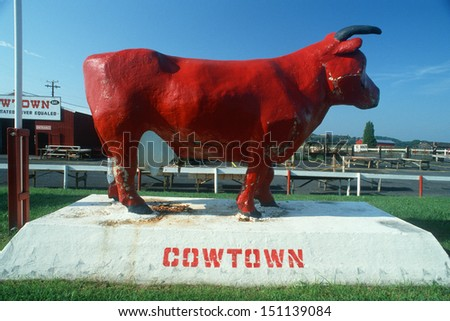 MIDWEST - CIRCA 1980's: Roadside attraction of an oversized cow - stock photo