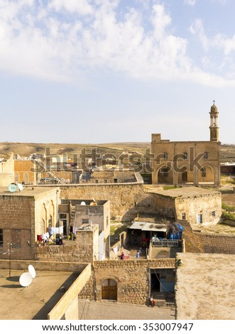 Midyat, Turkey - December 06, 2014 : Midyat old town view from Guest House. The ancient city of Midyat is located in southeast Turkey and has managed to preserve the old buildings and churches.