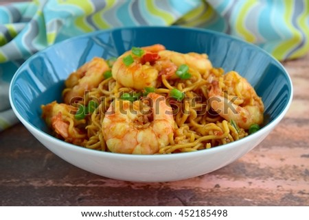 Mie goreng or bami goreng (indonesian cuisine). Fried noodles with prawns