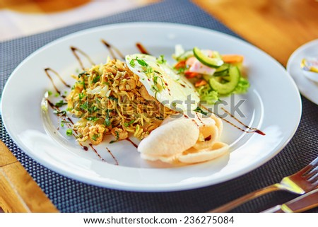 Mie goreng - spicy fried curry instant noodles, traditional Indonesian meal - stock photo