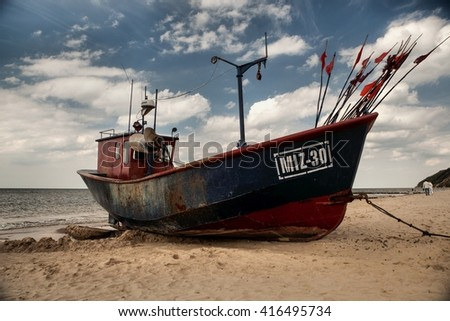 MIEDZYZDROJE, POLAND- JUNI 20, 2015: Fishing boat on the Baltic sea in Miedzyzdroje. - stock photo