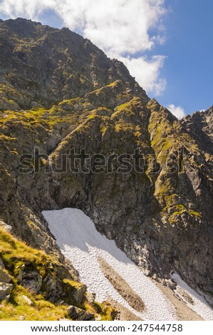 Mieguszowiecki Intermediate Peak and Eternal Snow  in the Foothills  - stock photo