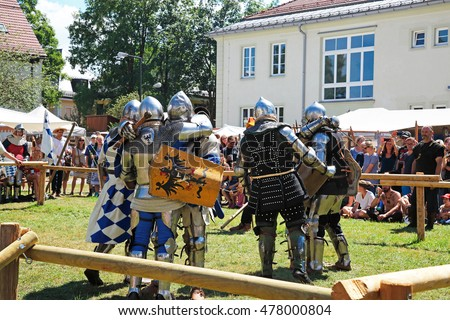 MIESBACH, GERMANY - AUGUST 7: knight's tournament on August 7, 2016. Medieval knight's teams fight during folks festival.