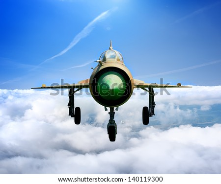 MiG-21  Soviet multipurpose jet plane in flight - stock photo