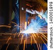 MIG welding in a factory - stock photo