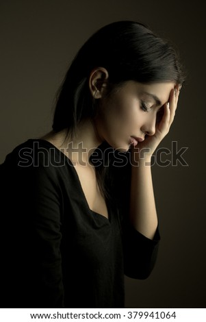 Migraine pain or stress concept. Sad unhappy woman