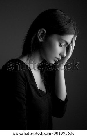 Migraine pain or stress depression concept. Sad unhappy teen woman