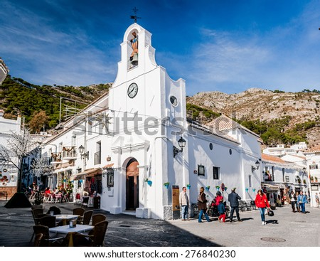 Mijas, Spain- January 05, 2014: Crowd of people and exterior of Saint Sebastian Church. Located on central street, it lined with cafes, restaurants and souvenir shops. Andalusia, Costa del Sol. Spain - stock photo