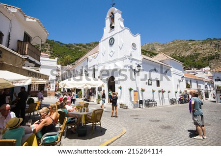MIJAS, SPAIN - JUNE 08: View of historic center on June 08, 2014 in Mijas, Malaga, Spain. Its centre is a typical Andalusian white-washed village, in the heart of the Costa del Sol region. - stock photo