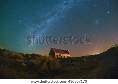Miky Way Rising Above Church Of Good Shepherd with Aurora Australis Lighting Up The Sky . Fish eye lens distortion and Noise due to high ISO; soft focus / shallow DOF due to wide aperture used. - stock photo