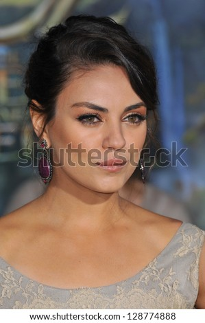 """Mila Kunis at the world premiere of her movie """"Oz: The Great and Powerful"""" at the El Capitan Theatre, Hollywood. February 13, 2013  Los Angeles, CA Picture: Paul Smith - stock photo"""