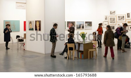MILAN - APRIL 07: People at paintings galleries at MiArt, international exhibition of modern and contemporary art April 07, 2013 in Milan, Italy. - stock photo