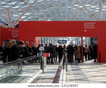 MILAN - APRIL 10: People at the entrance of Salone del Mobile, international home furnishing and architecture design exhibition on April 10, 2013 in Milan, Italy.