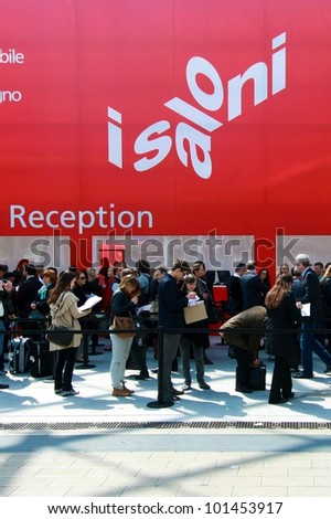 MILAN - APRIL 17: People crowd at exhibition reception before entering Salone del Mobile, international furnishing accessories exhibition on April 17, 2012 in Milan, Italy.
